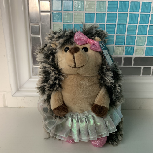 stuffed animal porcupine with tutu and bow